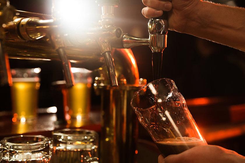 close-up-bartender-pouring-beer2.jpg