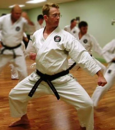 Kyoshi Mike Robertson practicing in a group class at Elmira Karate Dojo