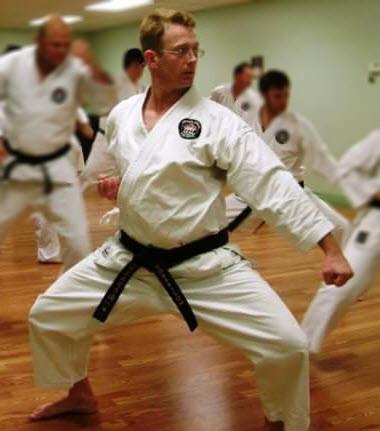 Kyoshi Mike Robertson practicing in a group class at Elmira Karate Dojo