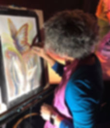Lisa DuBois painting a butterfly in pastel during live worship at Citipointe Church in Loveland Colorado