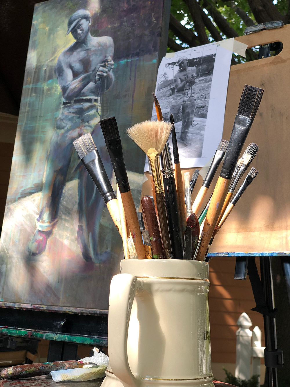 painting and paintbrushes in dappled sunlight