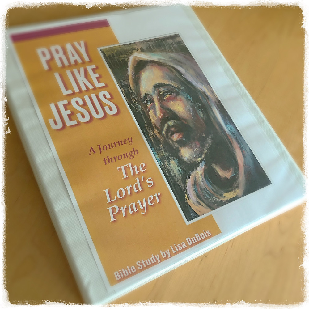 "Notebook cover with a painting of Jesus and a title ""Pray Like Jesus"", a Bible Study by Lisa DuBois"