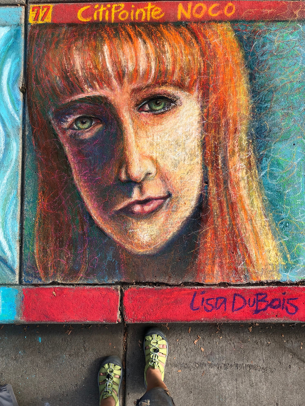 Pastel portrait of a red-headed woman, on sidewalk