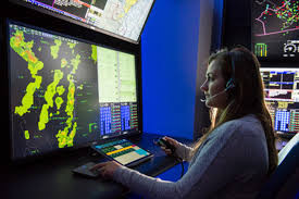 Female air traffic controller working in a radar room