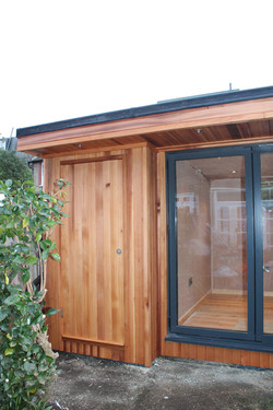 integrated cedar clad door to shed