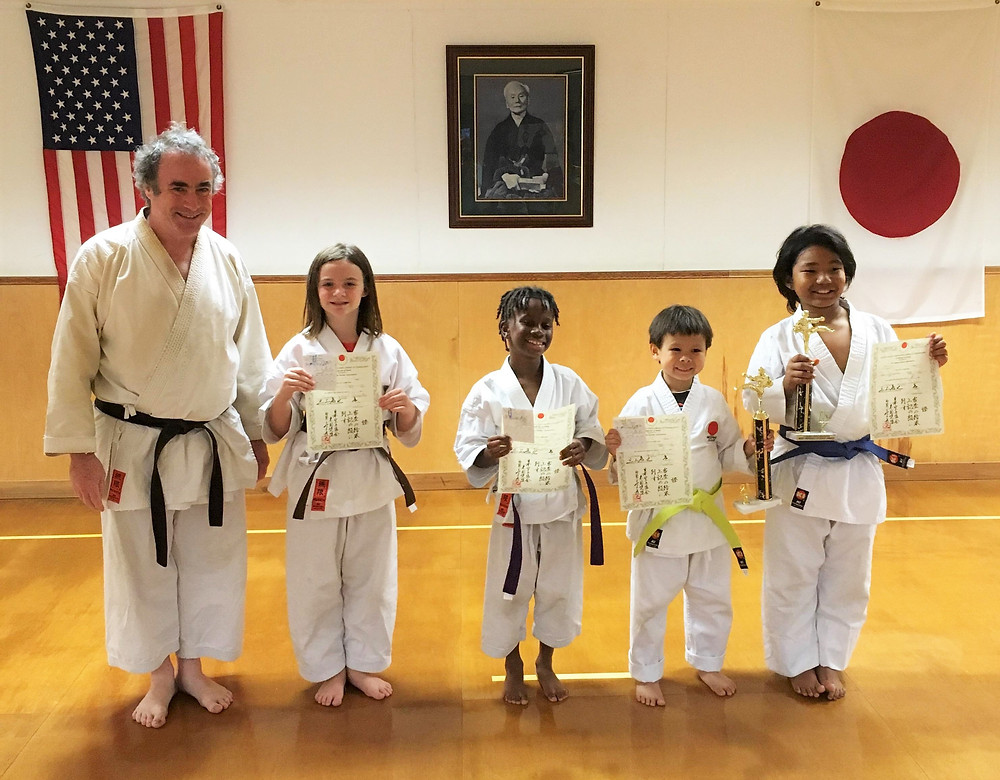 Kids in karate feel the joy and success of hard work after practicing to earn rank at our New Orleans dojo.