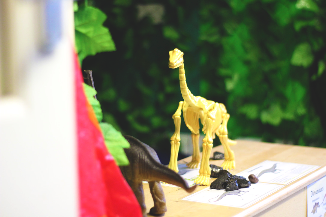 dino toy on shelf.png