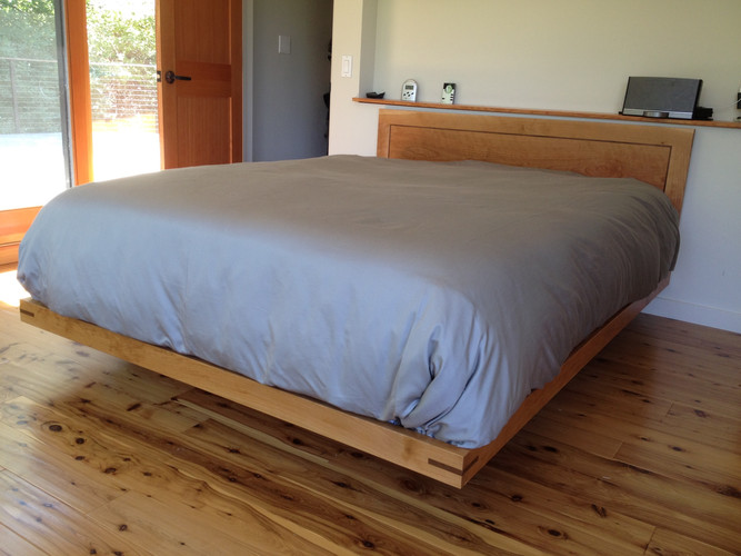 Bed frame and head board made with Cherry and Walnut accent.