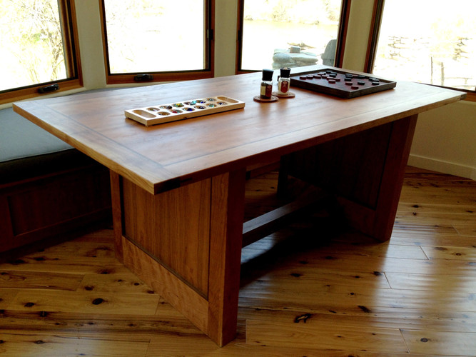 Dinning table made with Cherry and walnut accent.