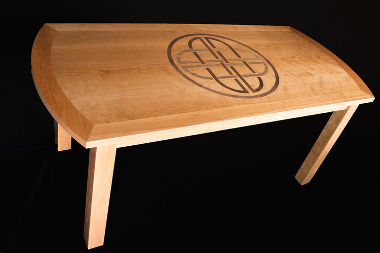 Dinning table made with cherry and walnut inlay