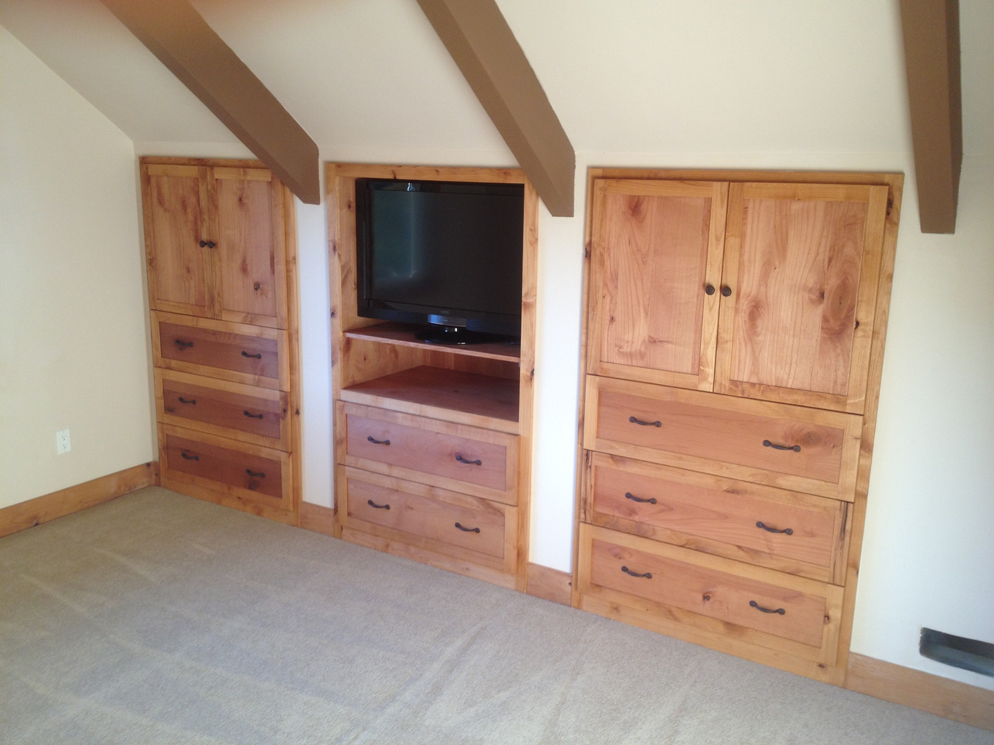 Built-in Armoirs made with Alder.