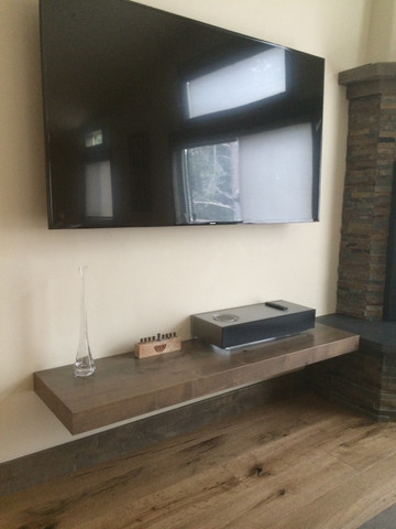 Floating shelf made with stained Alder.