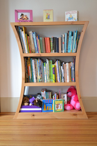 Curved bookcase made with Alder.