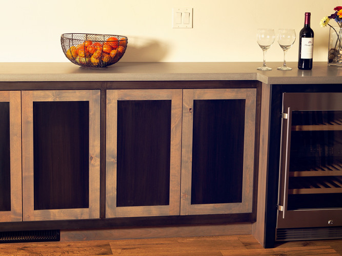 Metal and wood hybrid cabinet.  Black patina on steel and stained Alder.