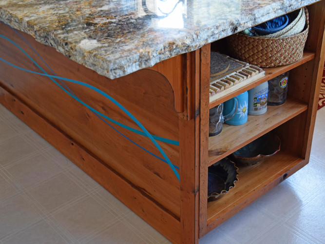 Kitchen island made with Rustic Cherry and epoxy inlay.