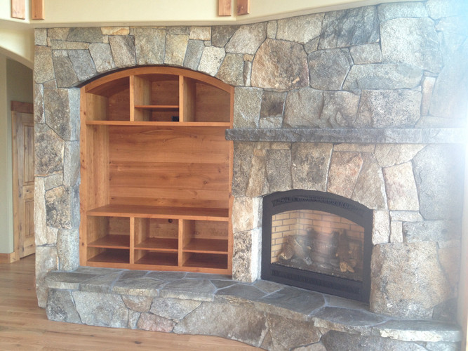 Entertainment center in stone, made with Alder.
