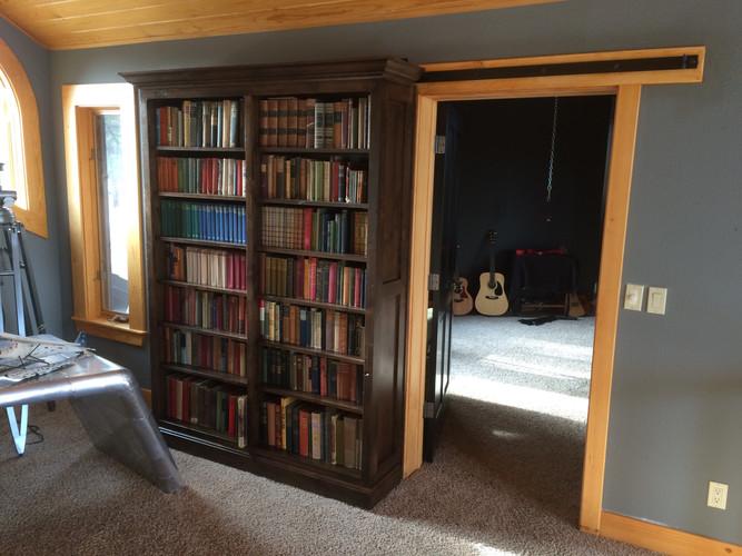 Bookcase on barn-door hardware (open).