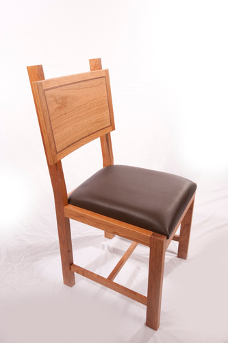 Dinning chair made with cherry, walnut accent and leather.