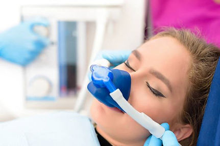 woman sedated with nitrous oxide for dental work