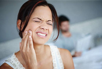 woman with painful dental emergency