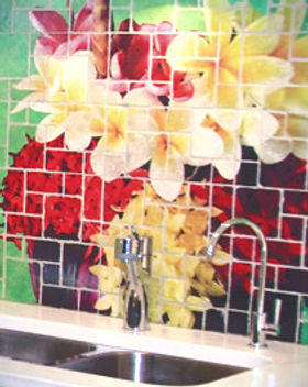 This tumbled marble mosaic backsplash was custom created using photo images.