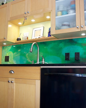 The name of this tempered glass kitchen backsplash is Jade Swirls.  Custom glass backsplash