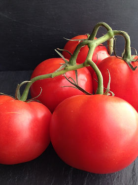 Foods like tomatoes are rich in antioxidants, which can combat UV radiation damage.