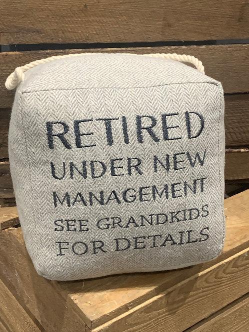 Retired Under New Management Doorstop