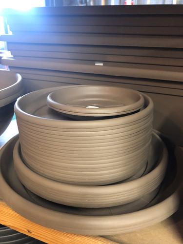 #59 Asst sizes plastic saucers