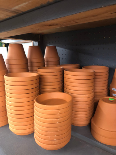 #9 Asst sizes terracotta pots and saucers
