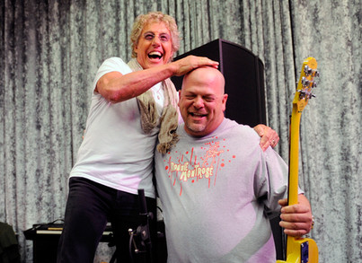 Singer Roger Daltrey of The Who and televison personalityRick Harrison