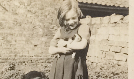 Dorothy with Lloyd the dog and one of her pups c. 1942-3.