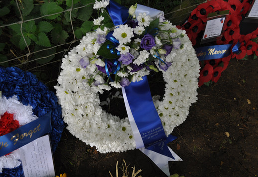 A beautiful fresh flower wreath laid by the family of Wireless Operator Albert Roberts