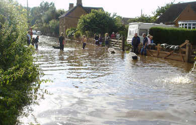 Residents gather in the floods outside Gorse View and Manor Cottages in 2007