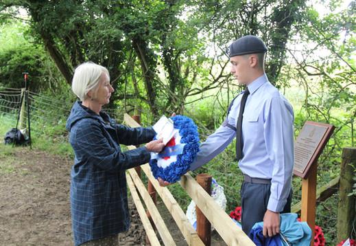 Penny Buchan lays a wreath on behalf of the family of Navigator Ken Lee