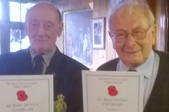 Gordon Spence and John Blundy receive th