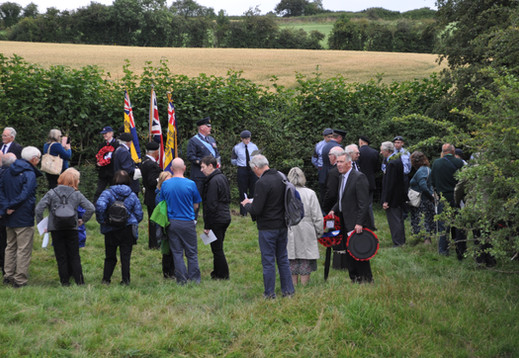 The congregation gathers at the crash site for the memorial service