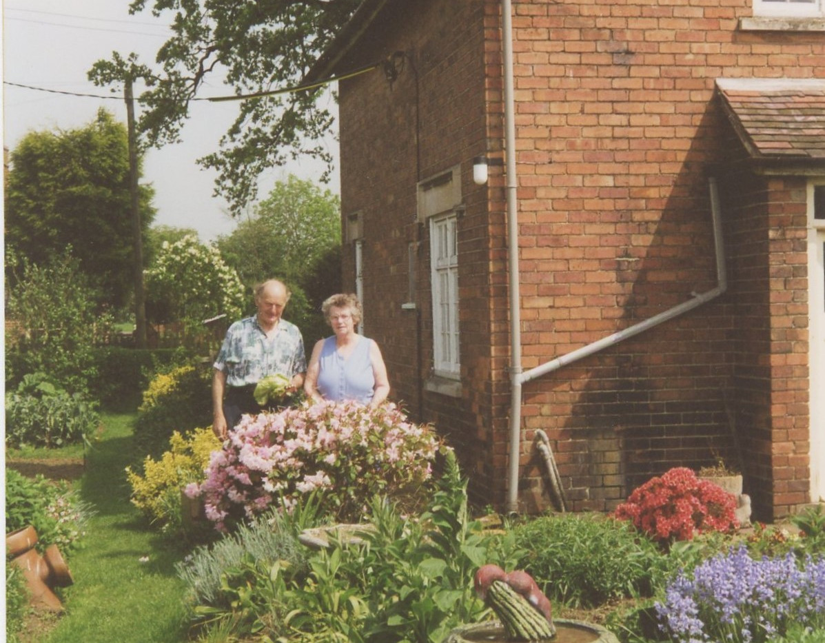 Stan & Nancy in the garden of their cottage