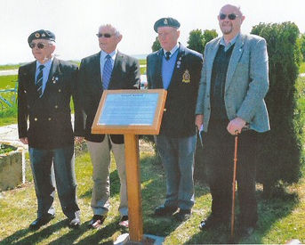 Gordon Spence at the memorial plaque unv