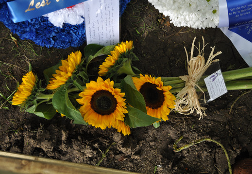 Fresh sunflowers laid on behalf of the Hubbard Family