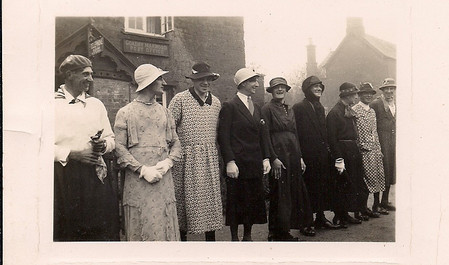 Men of the village dressed as women at the 1953 Coronation