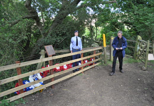 Rev Cannon John Barr reads the Exhortation following the unveiling of the memorial plaque