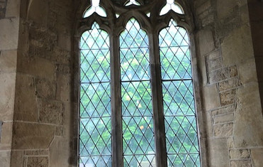 Traceried window in the west wall