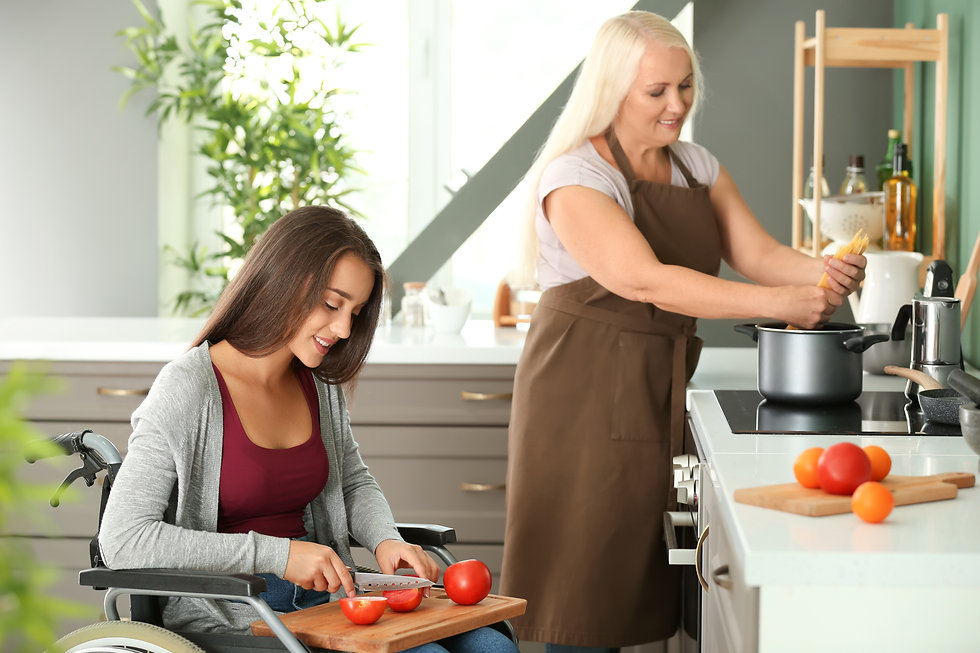 Young woman in wheelchair cooking togeth