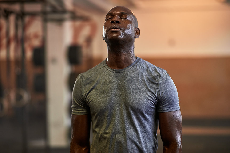 Fit young African American man standing
