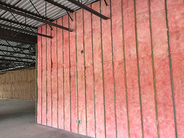 Pink fiberglass insulation in commercial building