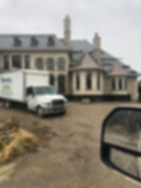 Insulation Man truck in front of custom new construction