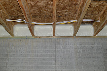 Closed-cell spray foam insulation in basement floor joists