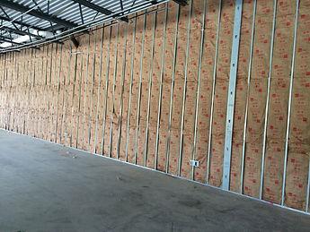 Kraft faced fiberglass batt insulation in commercial wall