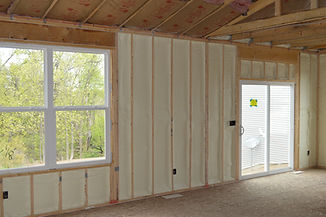 Closed-cell spray foam insulation in open cavity new construction